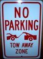 "NO PARKING TOW AWAY ZONE on a 12"" wide x 18"" high Aluminum Sign"