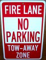 "FIRE LANE NO PARKING TOW on a 8"" wide x 12"" high Aluminum Sign"